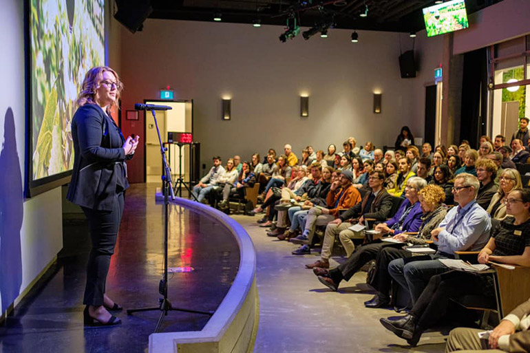 Portiaa McGonigal, 3MT 2020 winner, presents during last year's event.