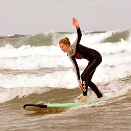 Candice Quin surfing