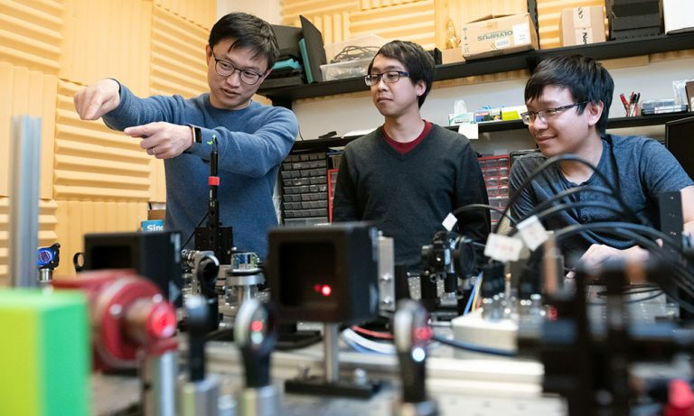 Isaac Li with students
