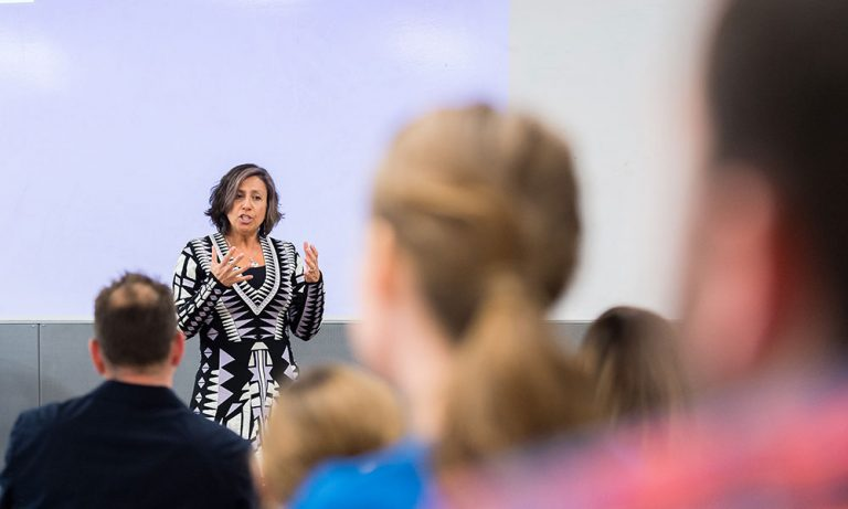 Karen Ragoonaden speaking to a classroom