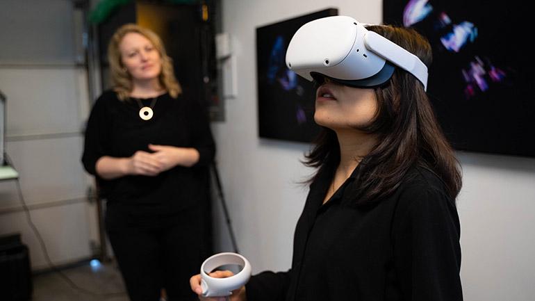 UBCO Associate Professor Megan Smith along with student Yugi Goa explore a virtual reality environment.