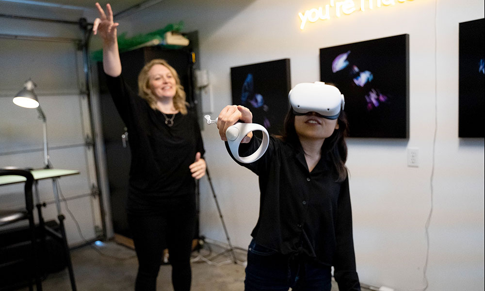 Megan Smith directing someone using a VR headset